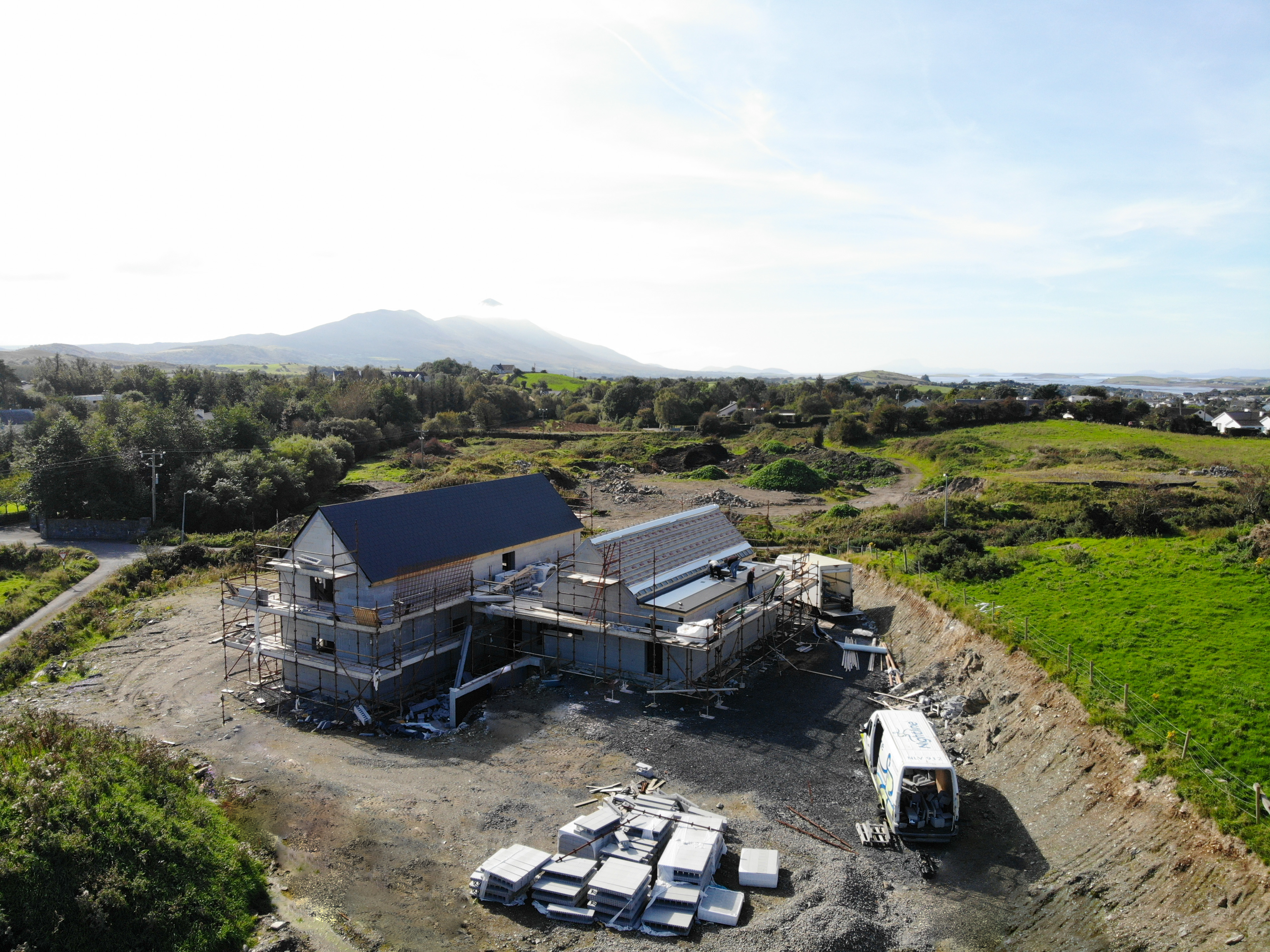 ICF house with finished roof on building site in Westport